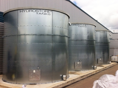Image of three large external cylinder water steel tanks used in post about sectional tanks